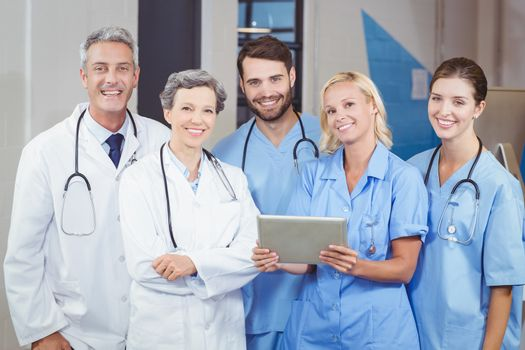 Portrait of cheerful doctor team with digital tablet