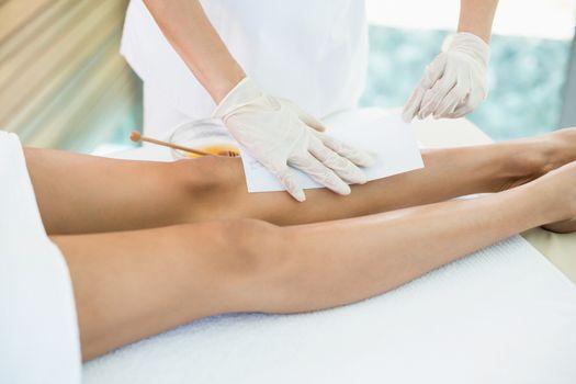 Woman receiving hot wax treatment