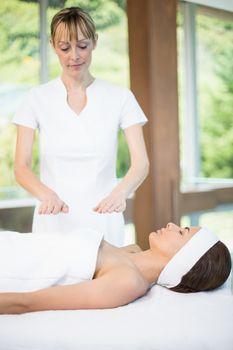 Female masseur massaging young womanMasseur massaging woman
