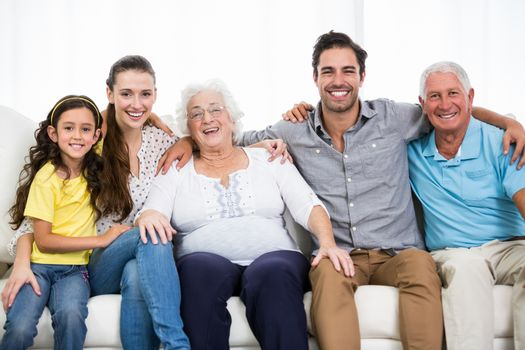 Portrait of smiling family with arm around