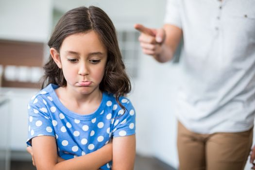 Midsection of father quarreling with daughter