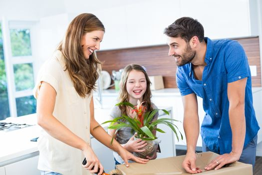 Smiling family packing box at home