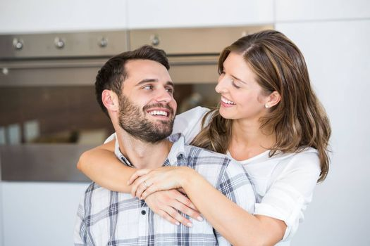 Close-up of smiling young couple at home