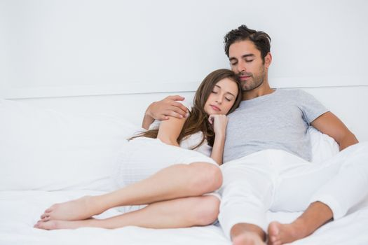 Young couple relaxing on bed at home