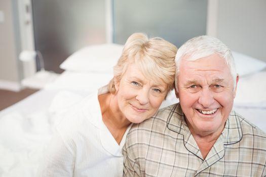 Portrait of happy senior couple in nightwear