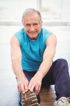 Senior man exercising at health club