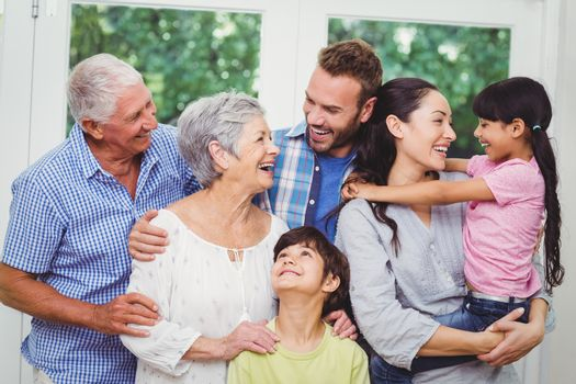 Cheerful multi generation family at home