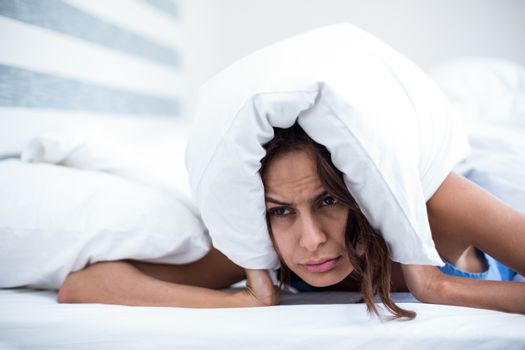 Irritated woman lying on bed