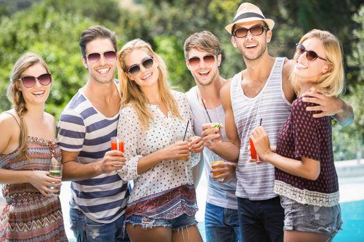 Group of happy friends having juice