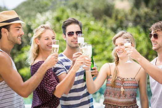 Group of friends toasting champagne flute