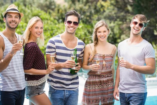 Group of friends having champagne