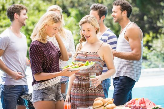 Friends preparing for outdoors barbecue party