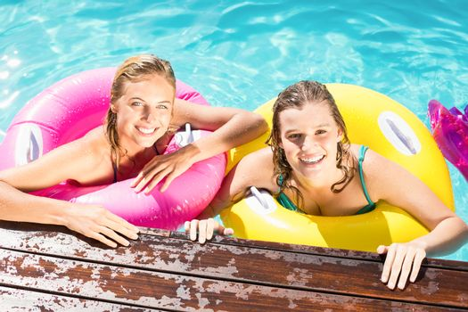Happy friends enjoying in the swimming pool