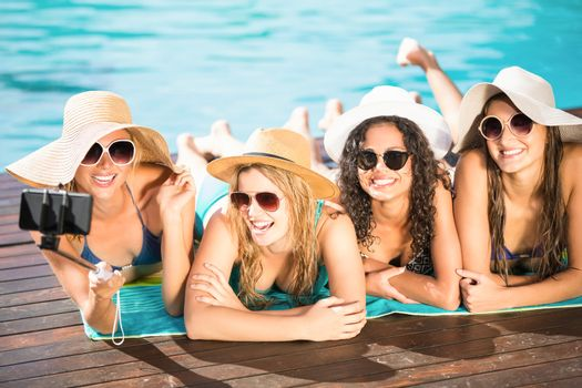 Happy friends enjoying at the swimming pool