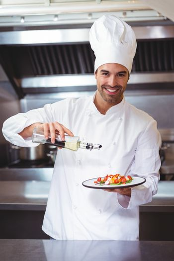 Chef putting finishing touch on salad