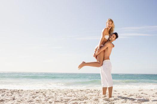 Boyfriend lifting his girlfriend