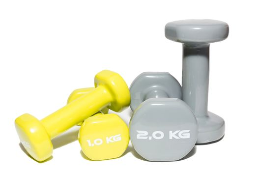 The photo shows a dumbbell on a white background