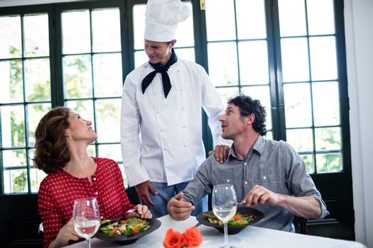 Chef talking to couple