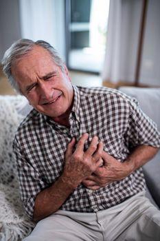Senior man suffering from heart attack
