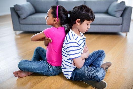 Upset siblings ignoring each other