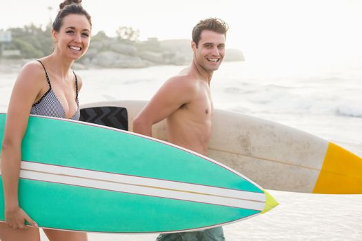 Couple with surfboard Walking on the beach