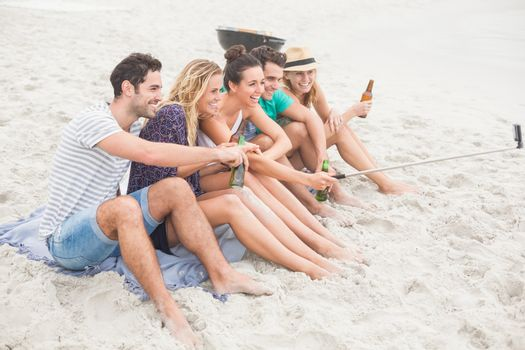 Group of friend taking a selfie on the beach