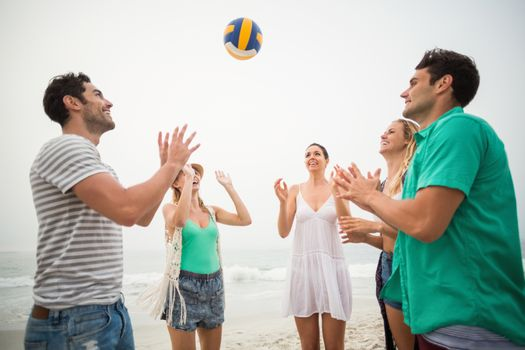 Group of friends playing with a beach ball