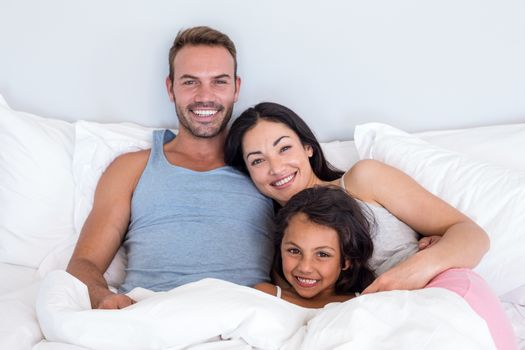 Happy family in their bedroom at home