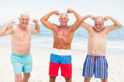 Senior men posing with their muscles