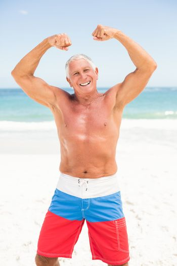 Senior man posing with his muscles