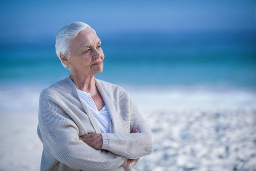 Thoughtful mature woman day dreaming