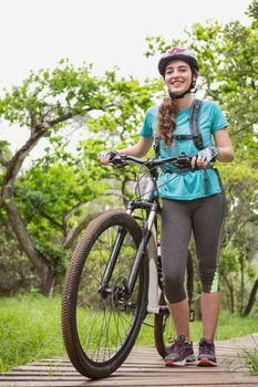 Woman pushing her bike