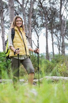 Smiling woman nordic walking