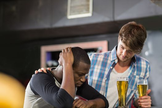 Man comforting his friend
