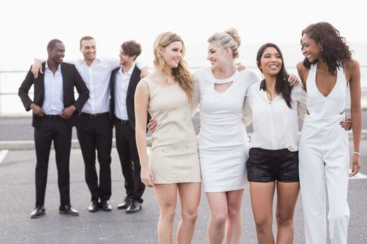 Well dressed people posing