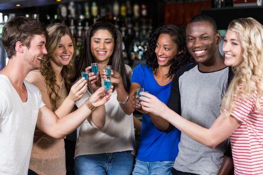 Group of friends having shots in a nightclub