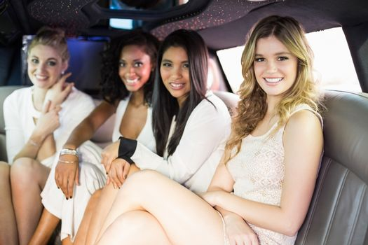 Well dressed women in a limousine
