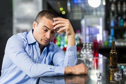Depressed man having a whiskey