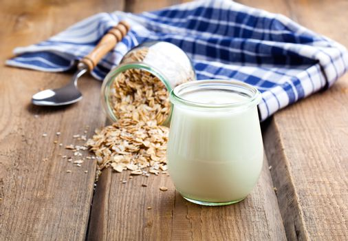 Delicious, nutritious and healthy yogurt in a glass jars with sp