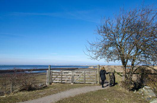 Woman goes through a farm gate