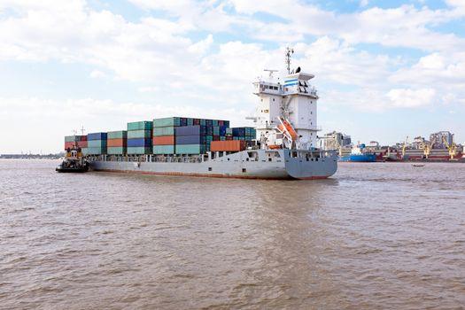 Containership on the Yangon river near Yangon in Myanmar
