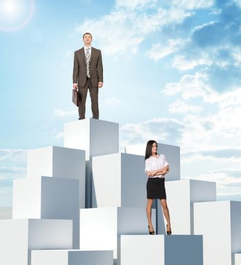 Business people on boxes pile on blue sky background