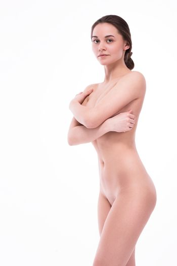 Nude with a smile looking at the camera