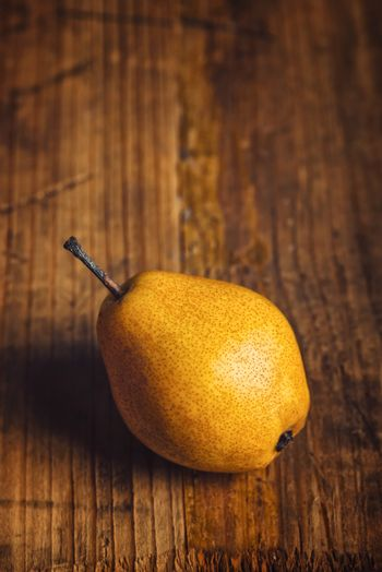 Yellow pear on wooden table