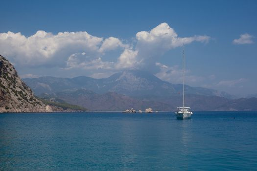 Mountains and sea and yacht