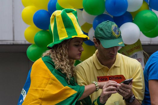 Sao Paulo Brazil March 13, 2016: One unidentified couple in the biggest protest against federal government corruption in Sao Paulo.
