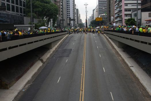 Sao Paulo Brazil March 13, 2016: One unidentified girl in the biggest protest against federal government corruption in Sao Paulo. Protesters call for the impeachment of President Dilma Rousseff.