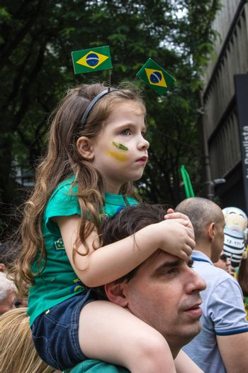 Sao Paulo Brazil March 13, 2016: One unidentified girl with one unidentified man in the biggest protest against federal government corruption in Sao Paulo.