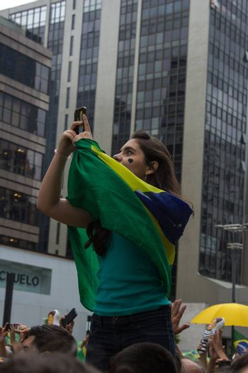 Sao Paulo Brazil March 13, 2016: One unidentified girl taking a selfie in the biggest protest against federal government corruption in Sao Paulo.