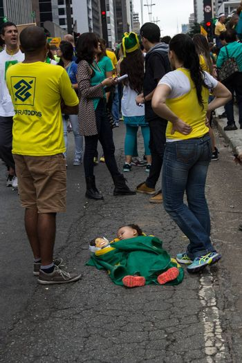 Sao Paulo Brazil March 13, 2016: One unidentified baby sleeping in the biggest protest against federal government corruption in Sao Paulo.